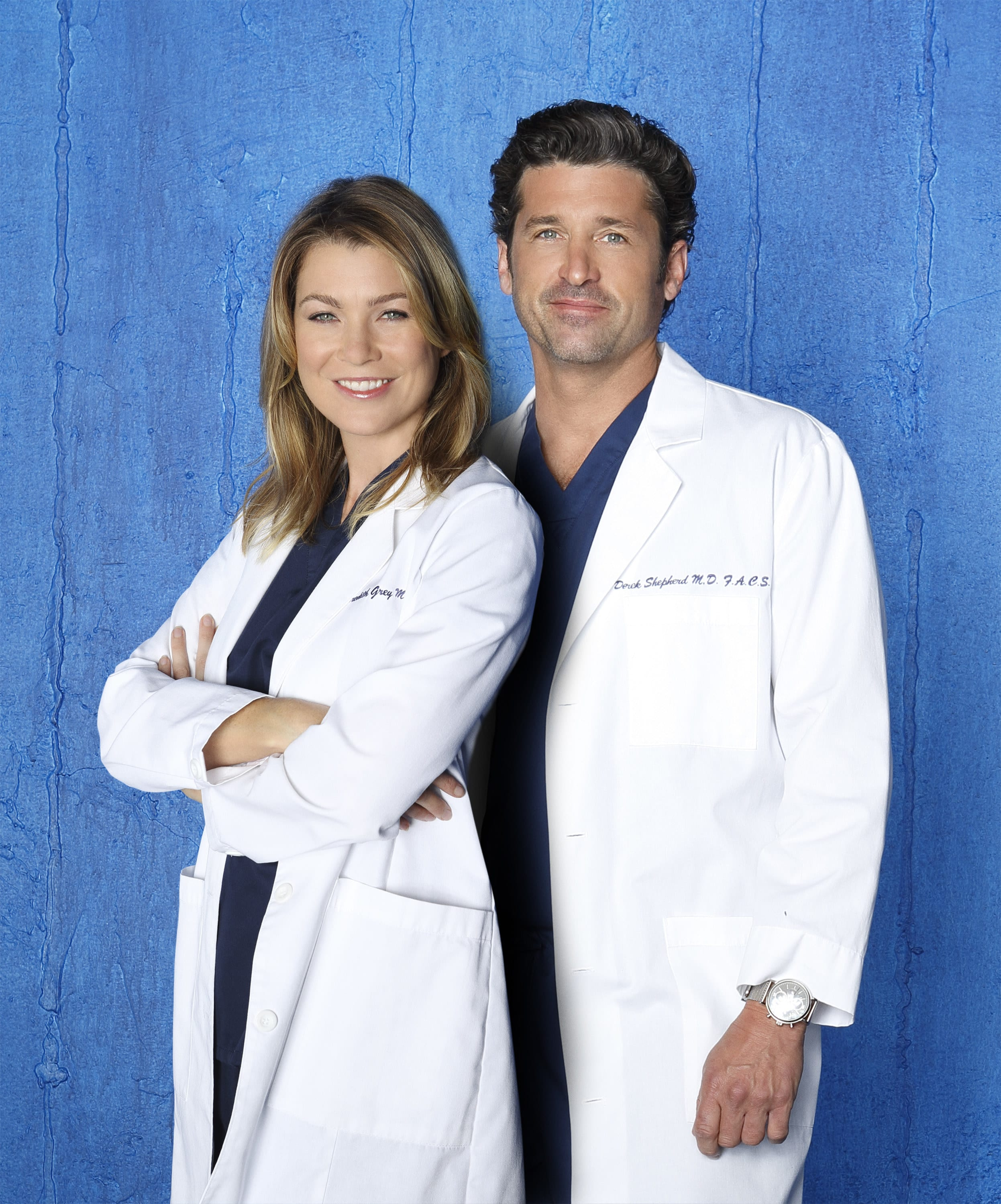 Ellen Pompeo crosses her arms with her back to Patrick Dempsey in matching lab coats