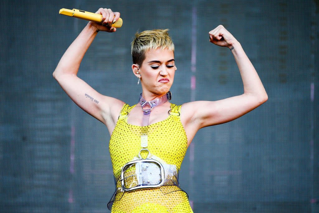 Katy Perry flexes her muscles during a performance