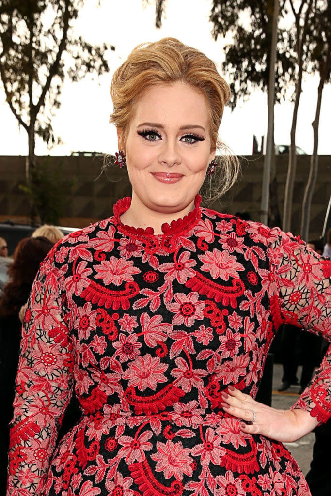 Adele arrives at the 55th Annual Grammy Awards in a embroidered floral tea-length dress