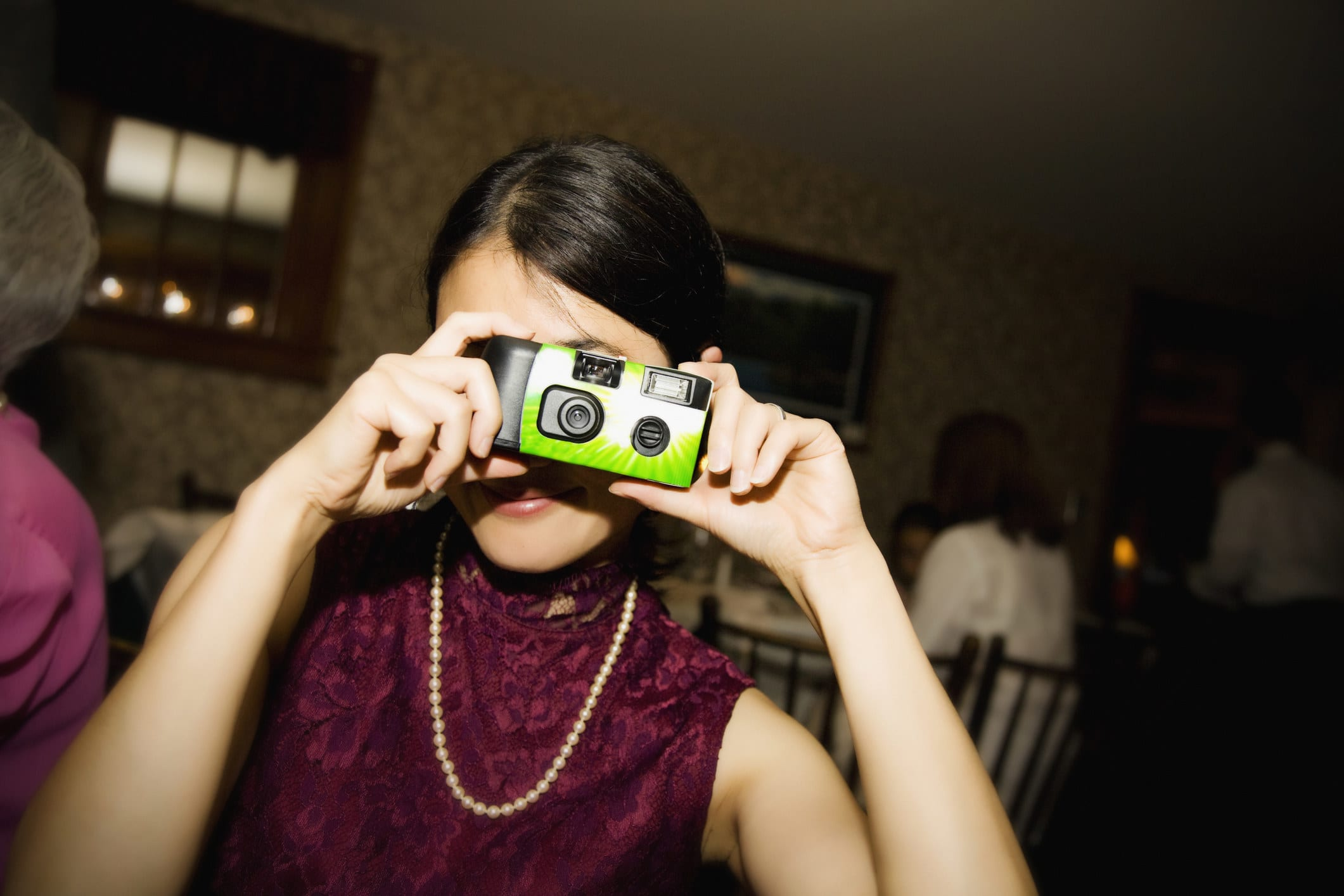 Someone takes a photo using a disposable camera