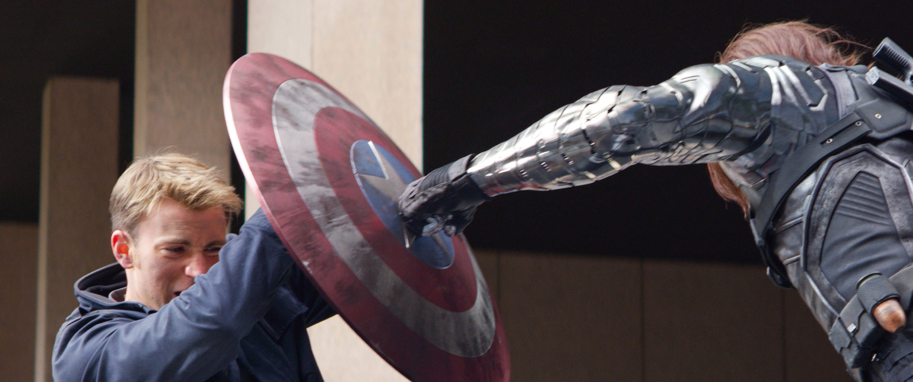 Captain America blocks a punch from the Winter Soldier with his shield