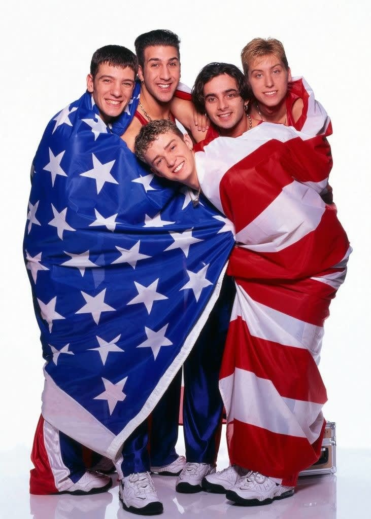 they are hugging under an american flag