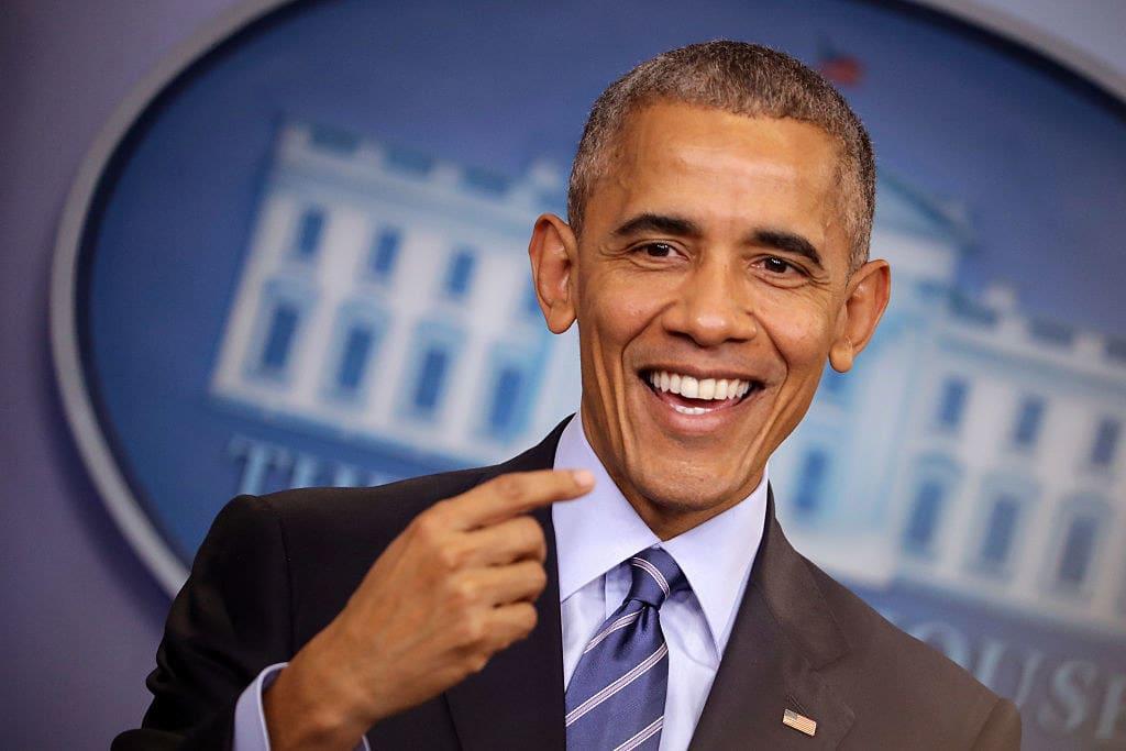 Obama smiles as he addresses the press
