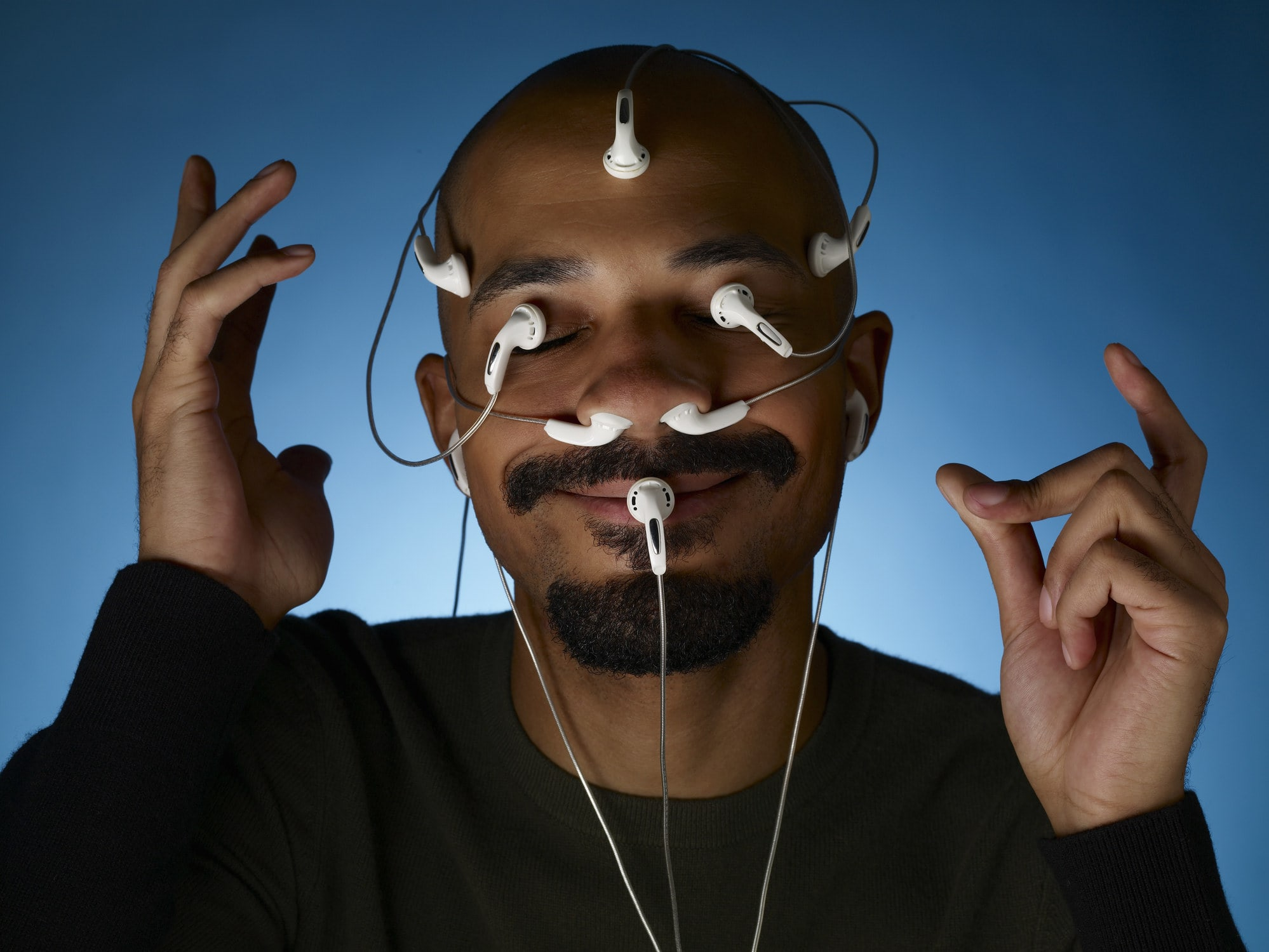 man with headphones all over his face