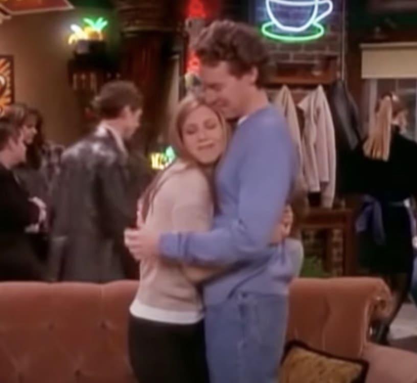 Rachel hugs Joshua in the middle of Central Perk