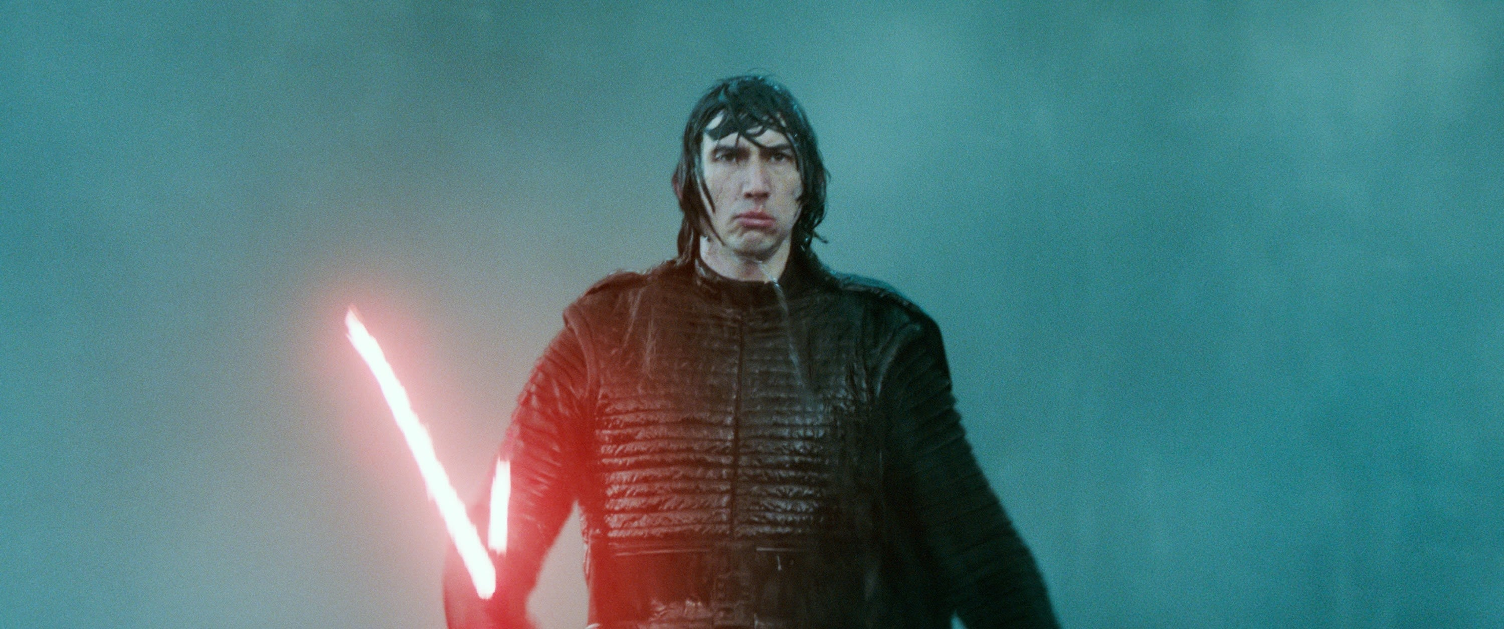 """Kylo Ren holding his iconic lightsaber in """"Star Wars"""""""