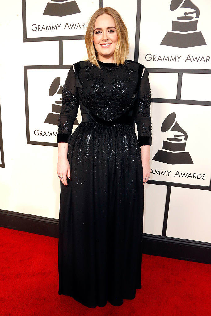Adele smiles on the red carpet of the 58th Grammy Awards
