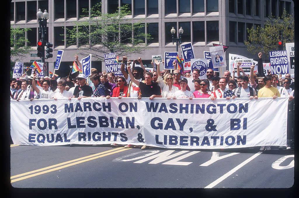 Participants carry a banner during the Gay Rights March April 25, 1993, in Washington, DC