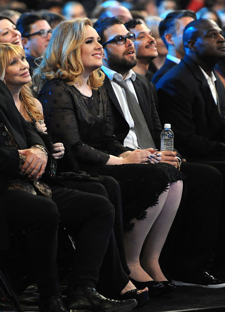 Adele and Simon Konecki sitting in the front row at the 54th Annual Grammy Awards