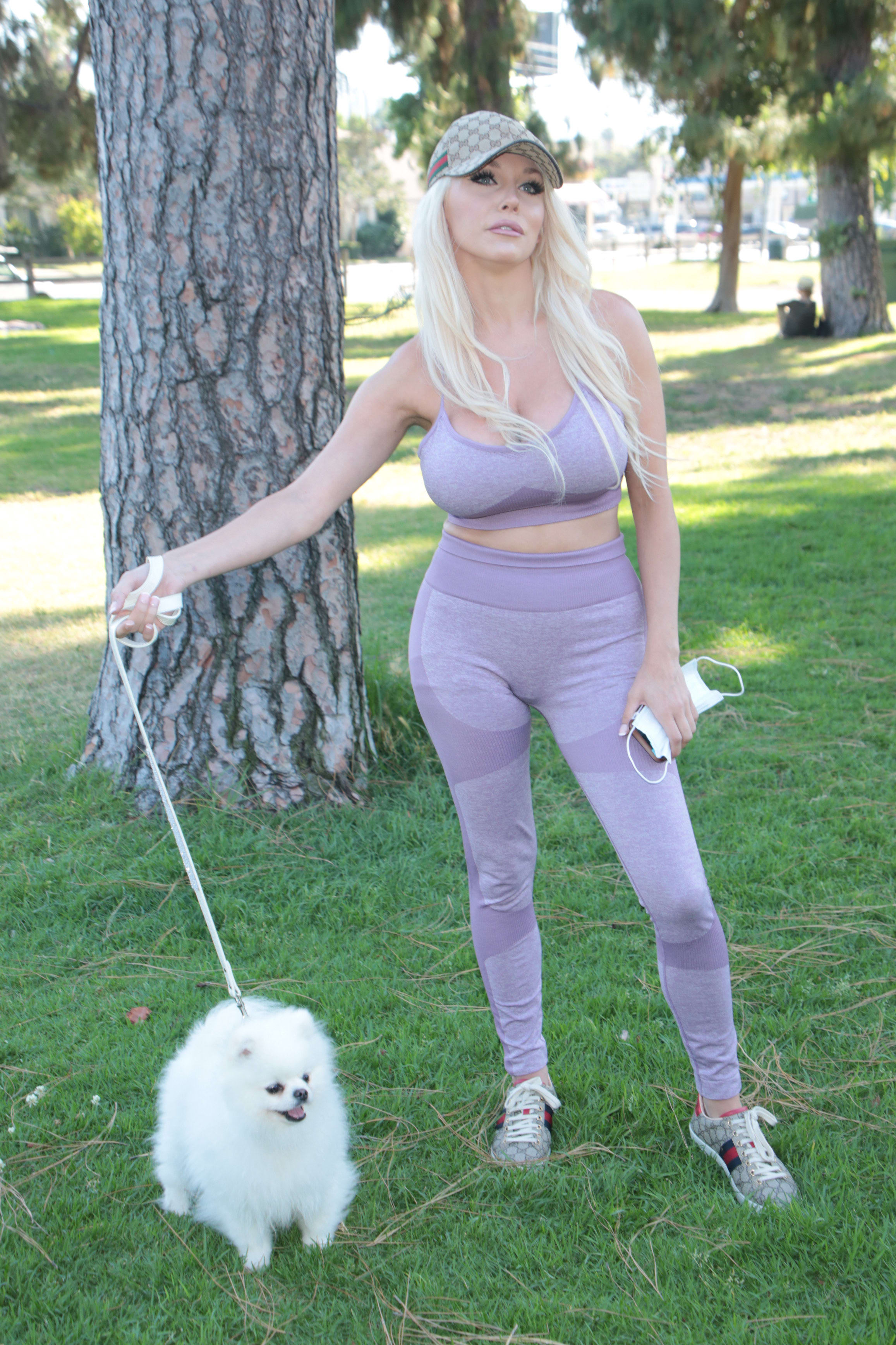 Courtney in a park with their dog
