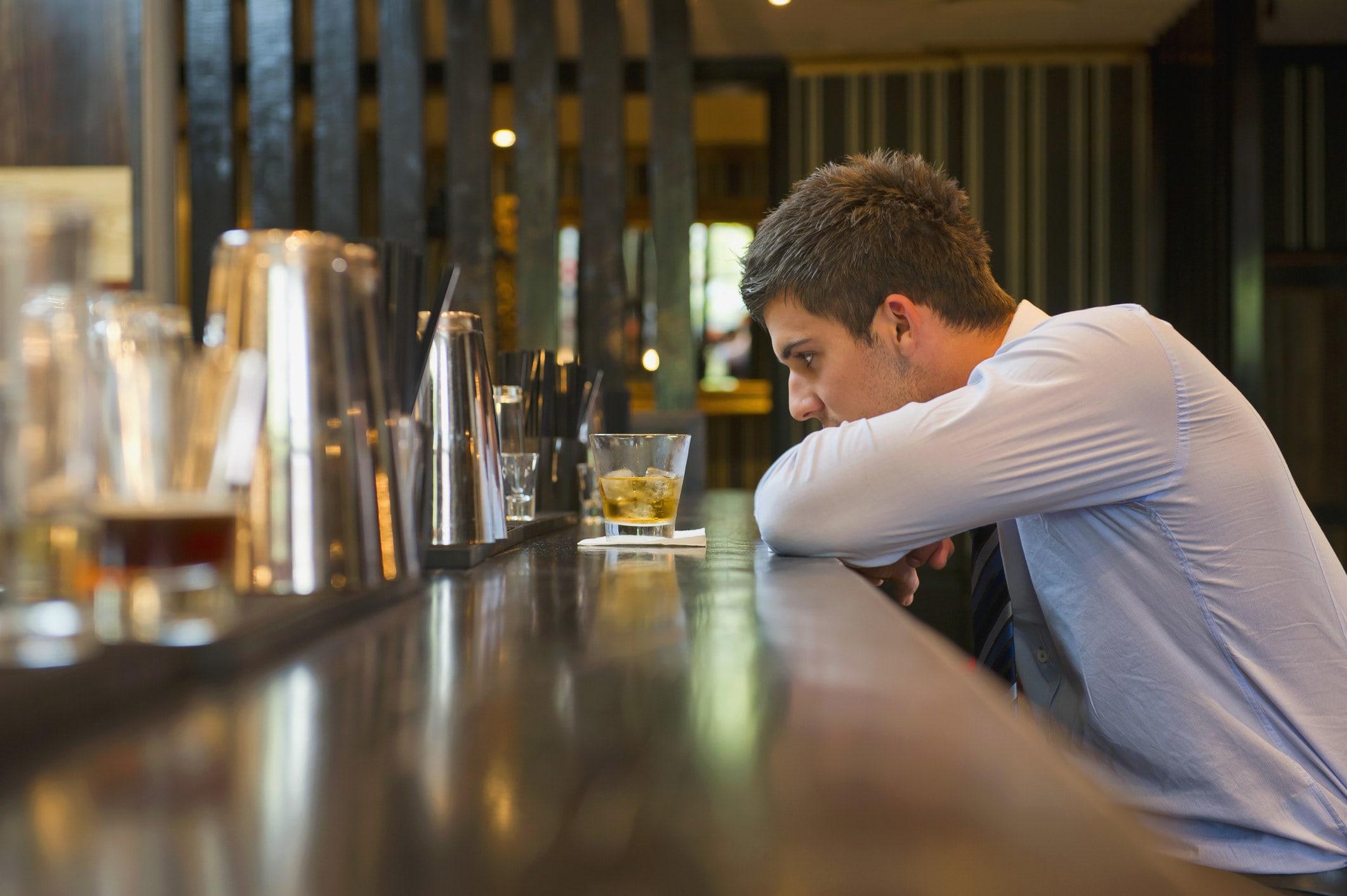 A man alone at a bar