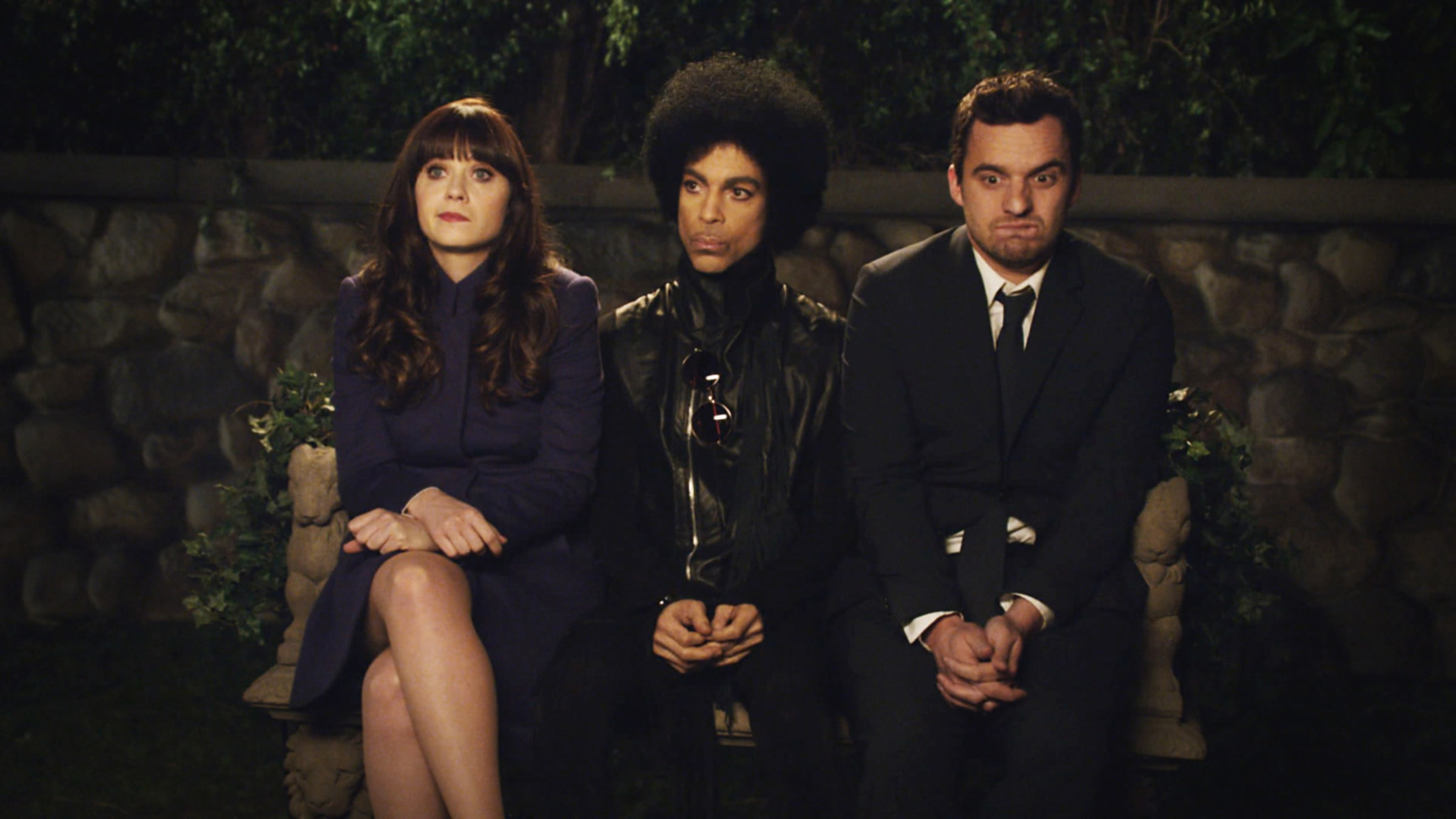 Prince sitting with the stars of New Girl