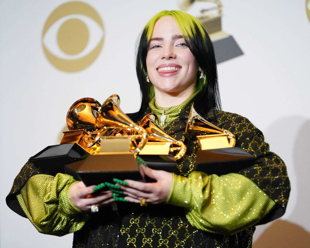 Billie Eilish holds four of her Grammy Awards