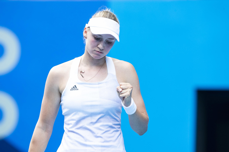 Kazakh tennis player pumping their fist