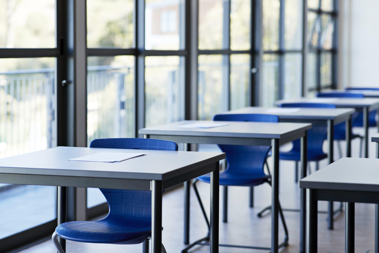 A university classroom with desks