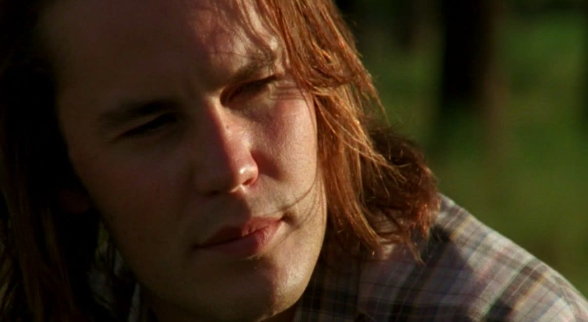 Close up of Tim Riggins as he sits in the sun