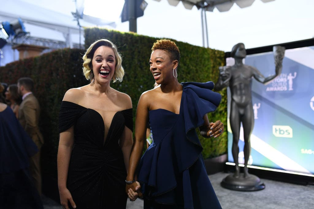 Samira and Lauren holding hands at an awards event