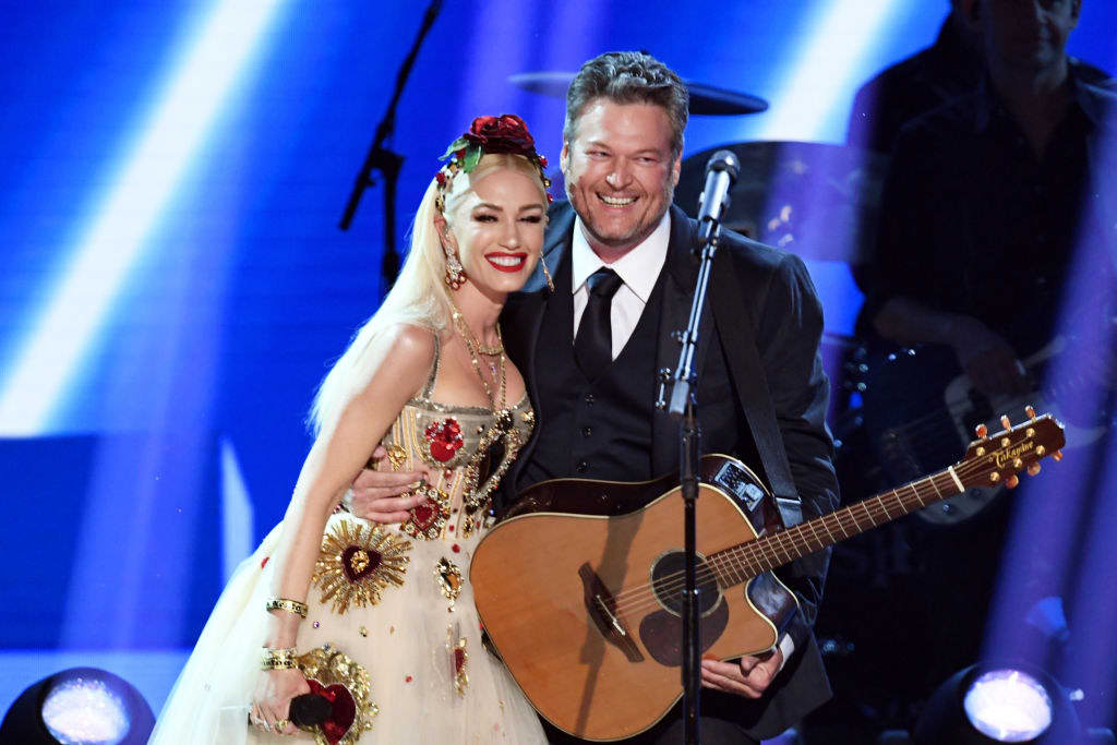Gwen and Blake on stage after a performance