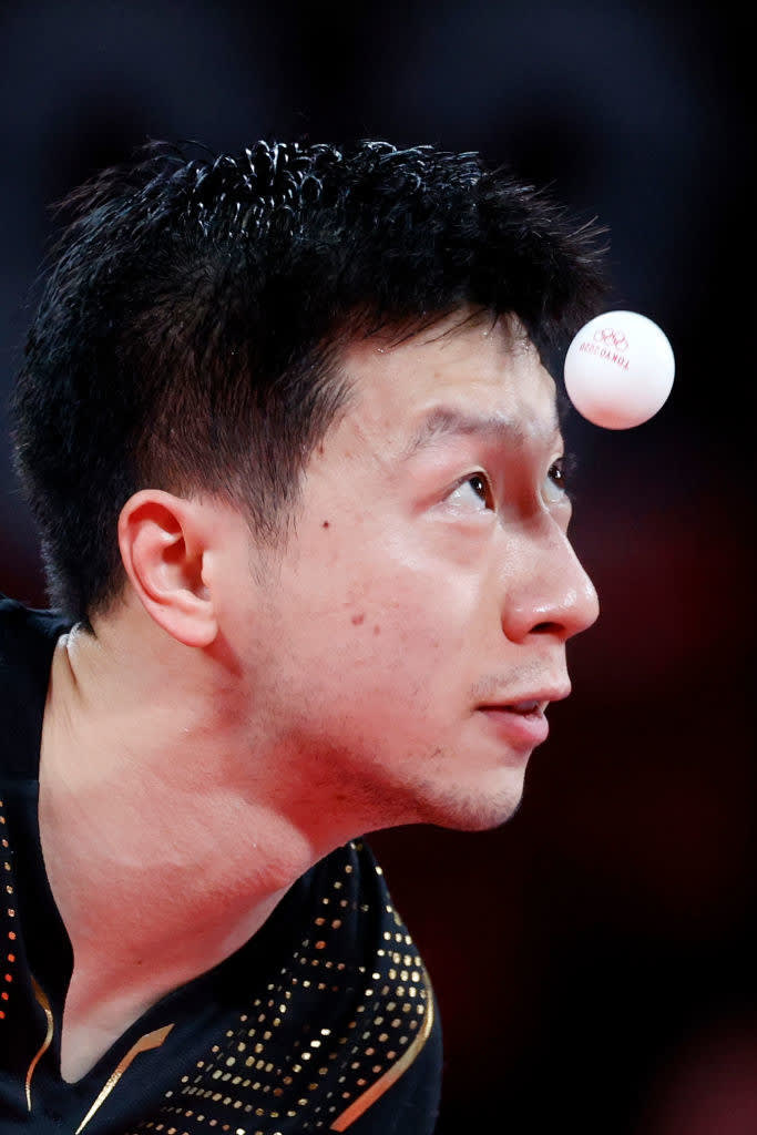 The athlete staring at the pingpong ball as it floats incredibly close to his head