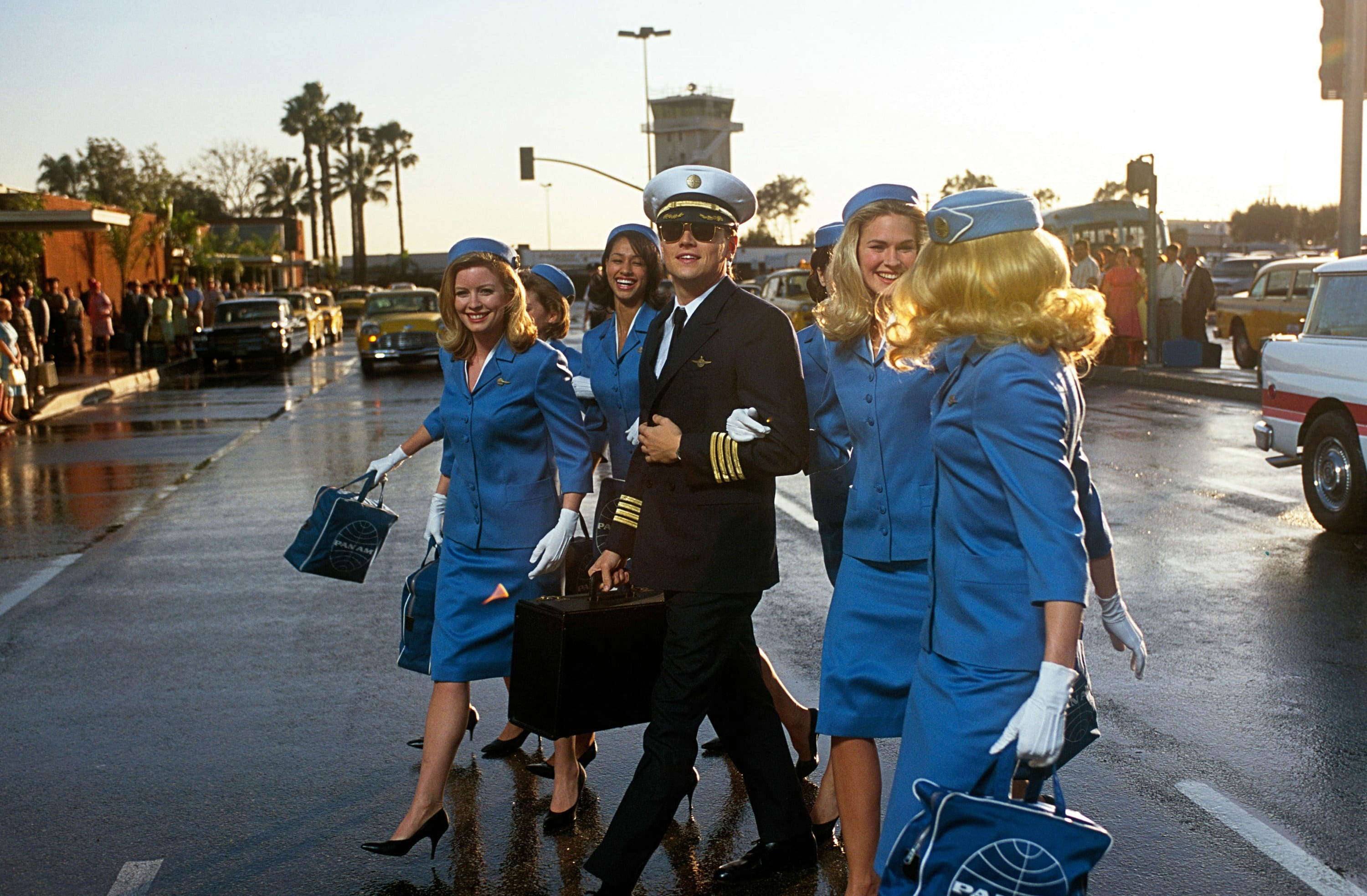 """Leonardo DiCaprio walking with a group of flight attendants in """"Catch Me if You Can"""""""