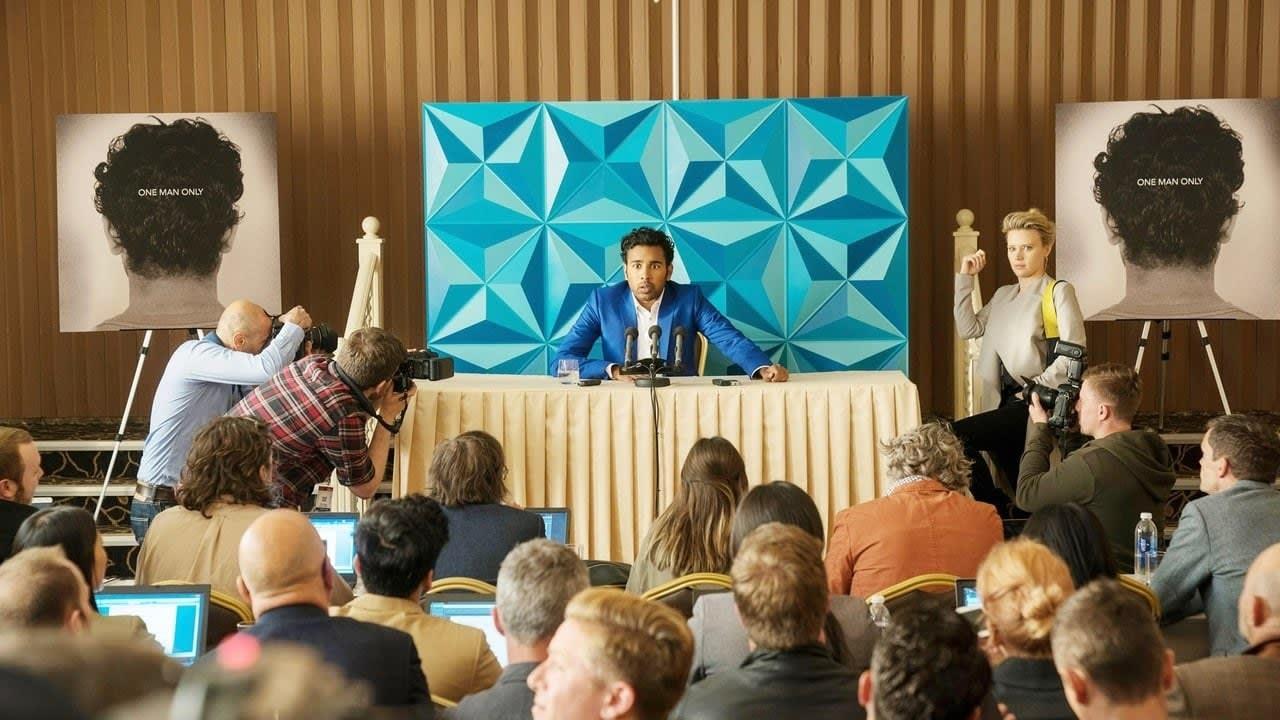 Imagem do filme mostra o personagem em uma espécie de coletiva de imprensa.