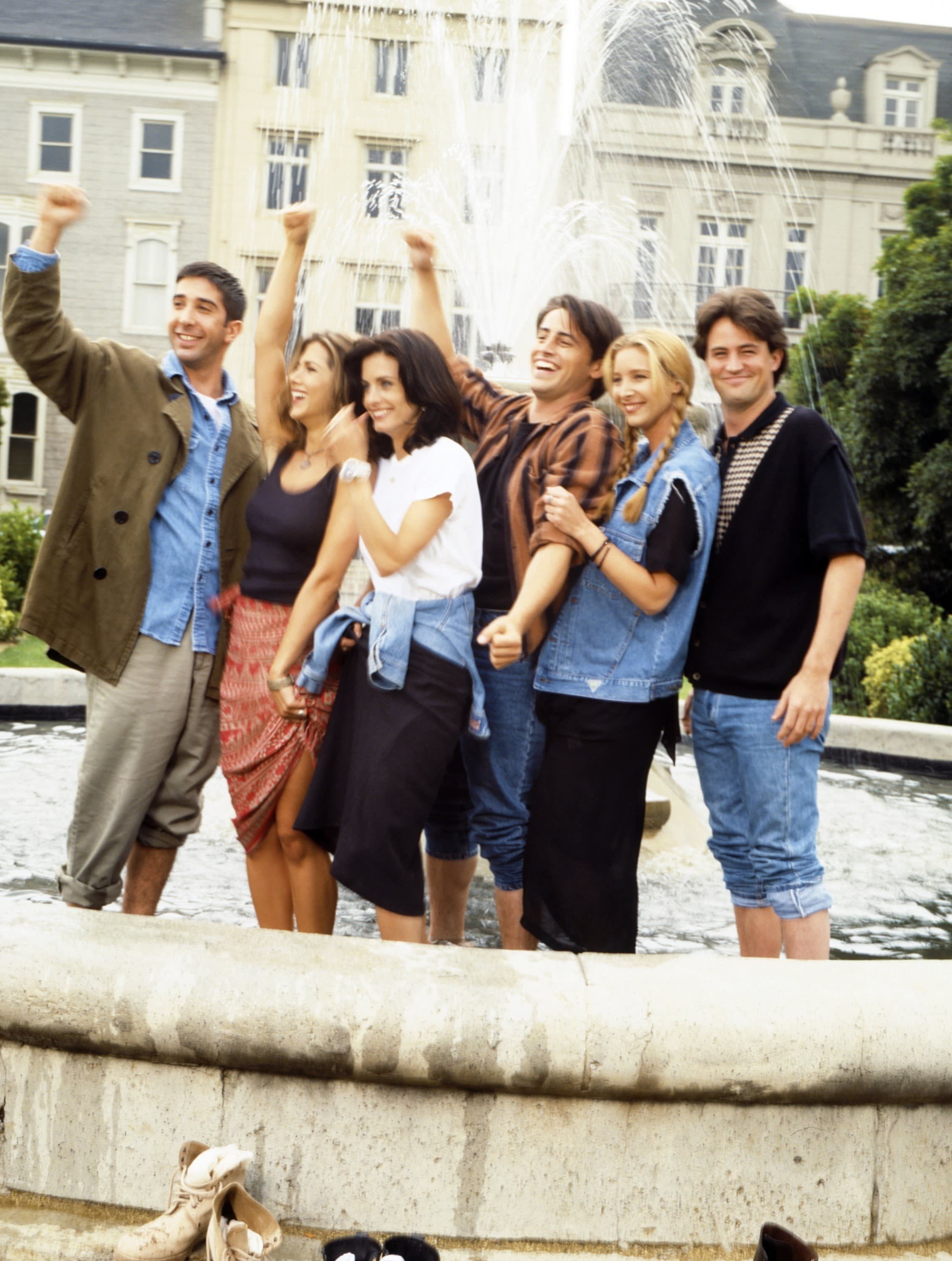 The cast of Friends standing in the fountain