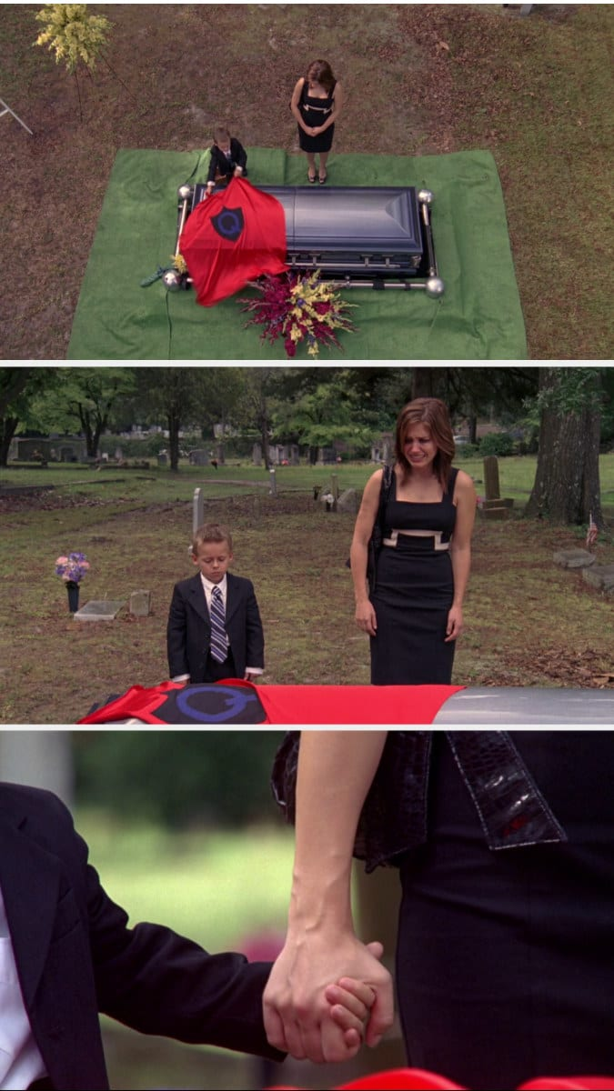 Brooke crying and holding Jamie's hand after he puts the cape over the casket
