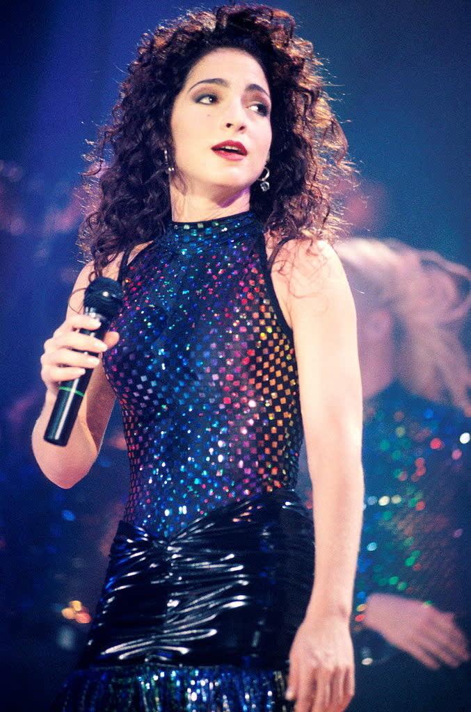 Gloria Estefan performing on stage in 1991