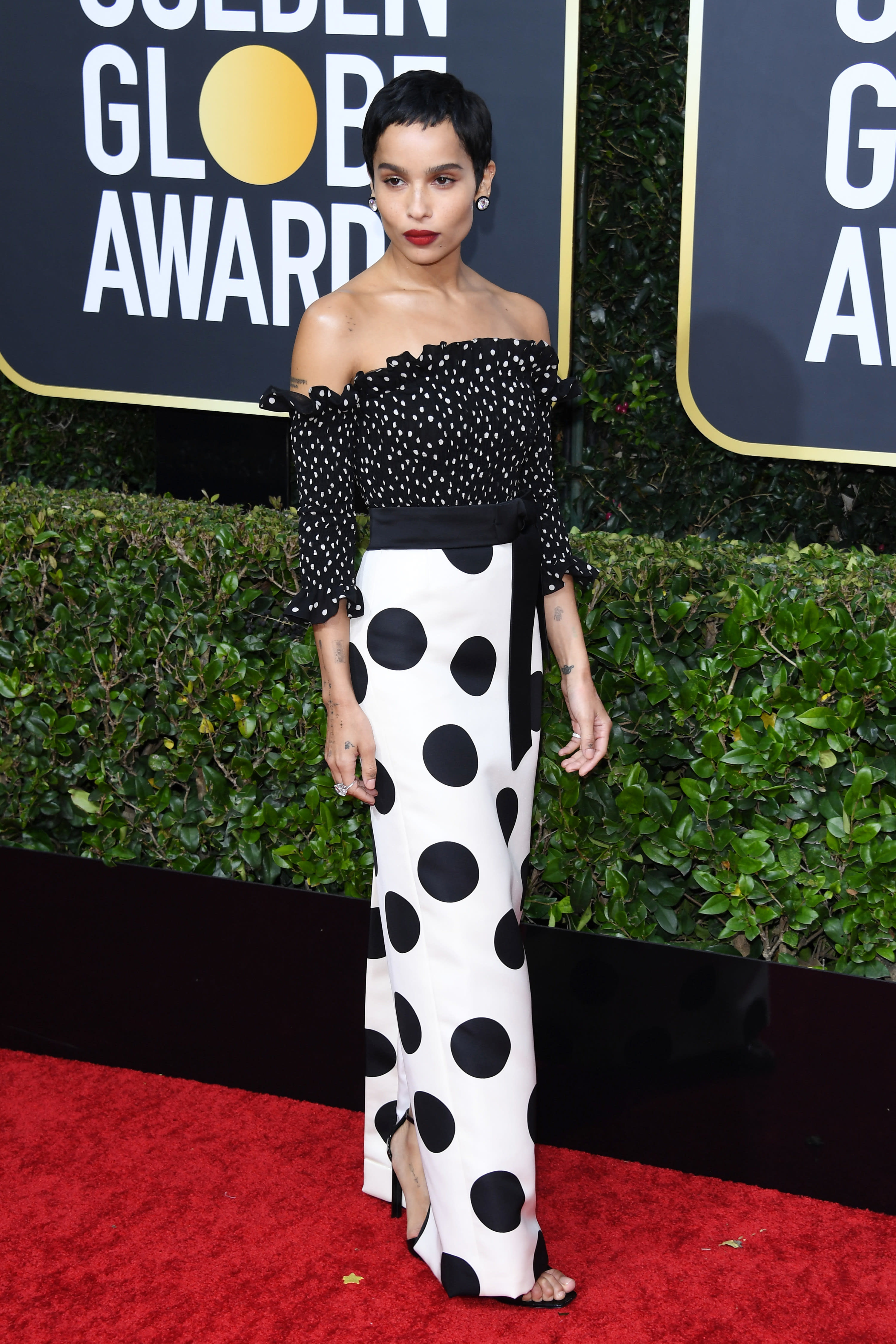 Zoe in polka dot gown on red carpet