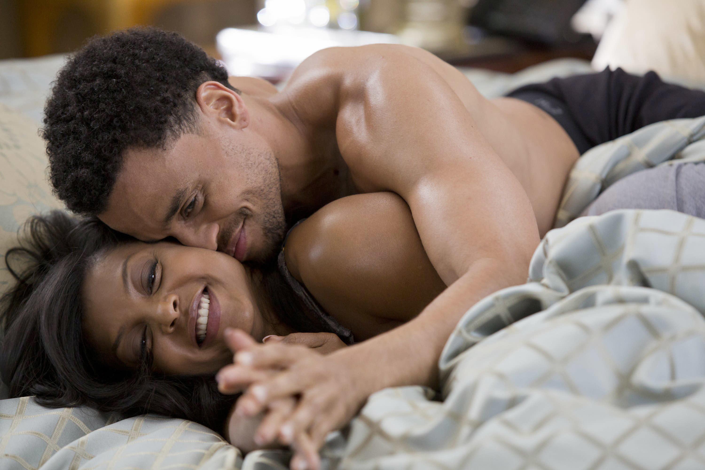 "Michael Ealy and Taraji P. Henson cuddling in ""Think Like A Man Too"""