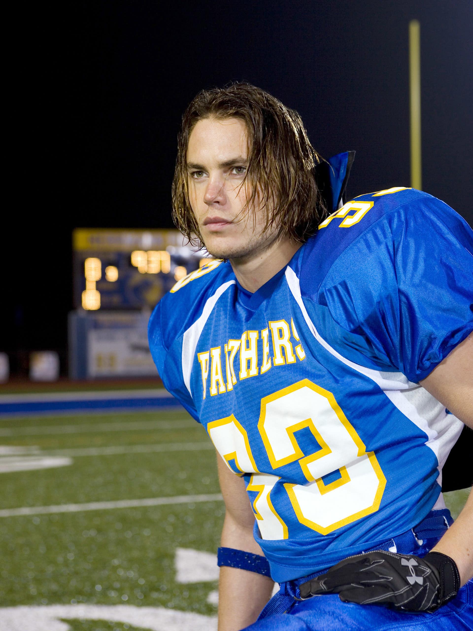 Taylor Kitsch in a football uniform
