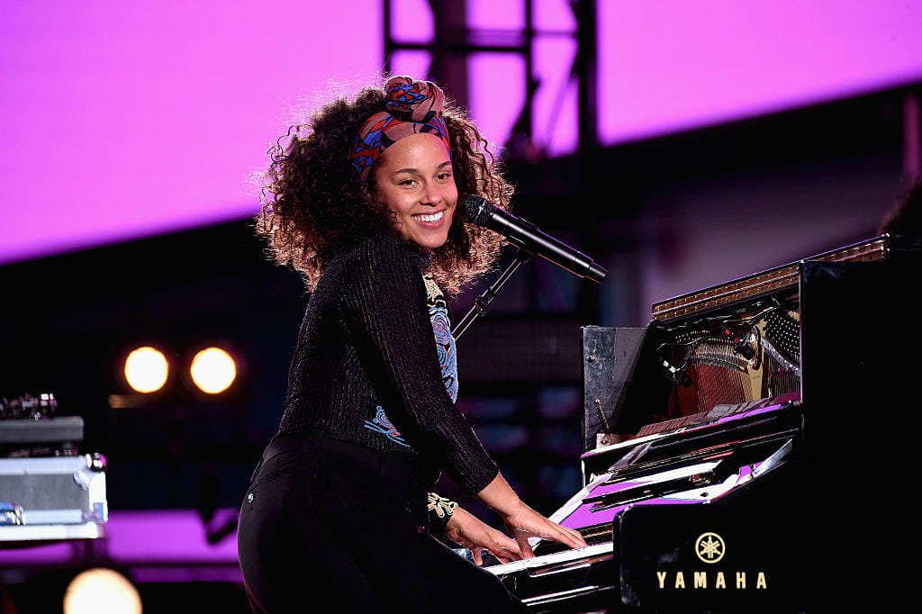 Keys performs on the piano in a concert
