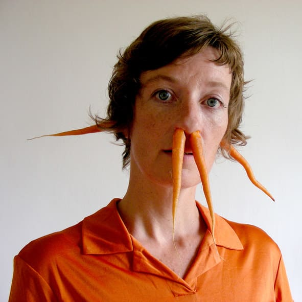 woman with carrots coming out of her nose and ears