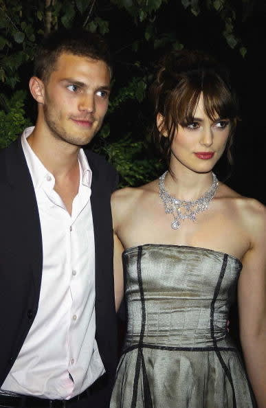 """Actor who played Christian Grey in """"50 Shades of Gray"""" and actor who played Elizabeth Swan in """"Pirates of the Caribbean"""" standing together"""