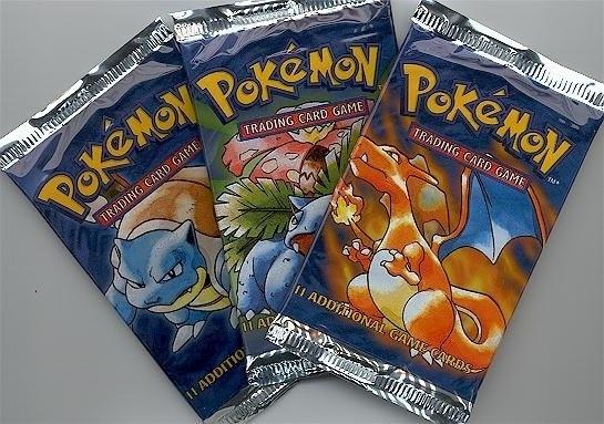 Three packs of Pokemon cards
