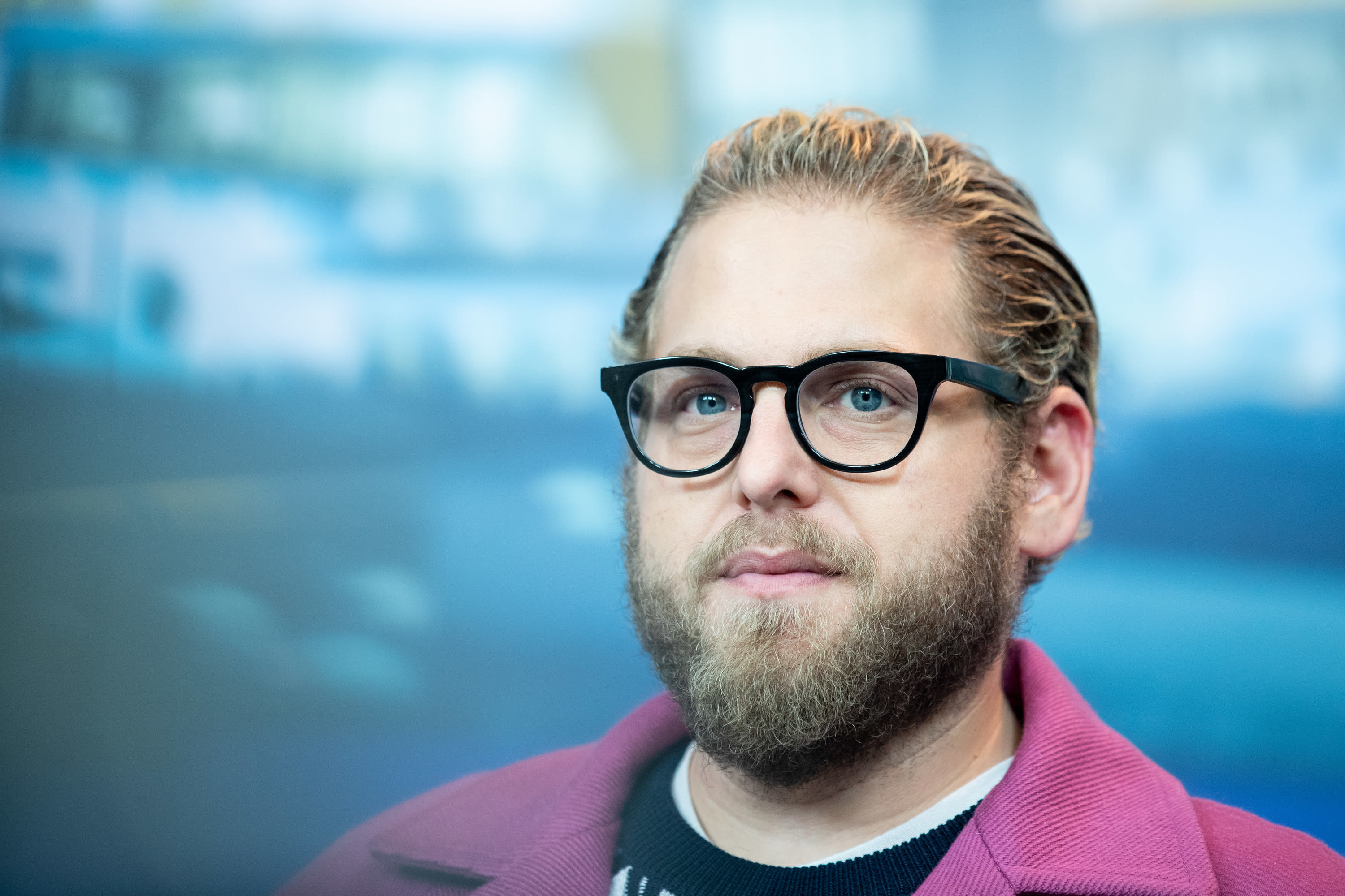 A head shot of Jonah with glasses and a beard