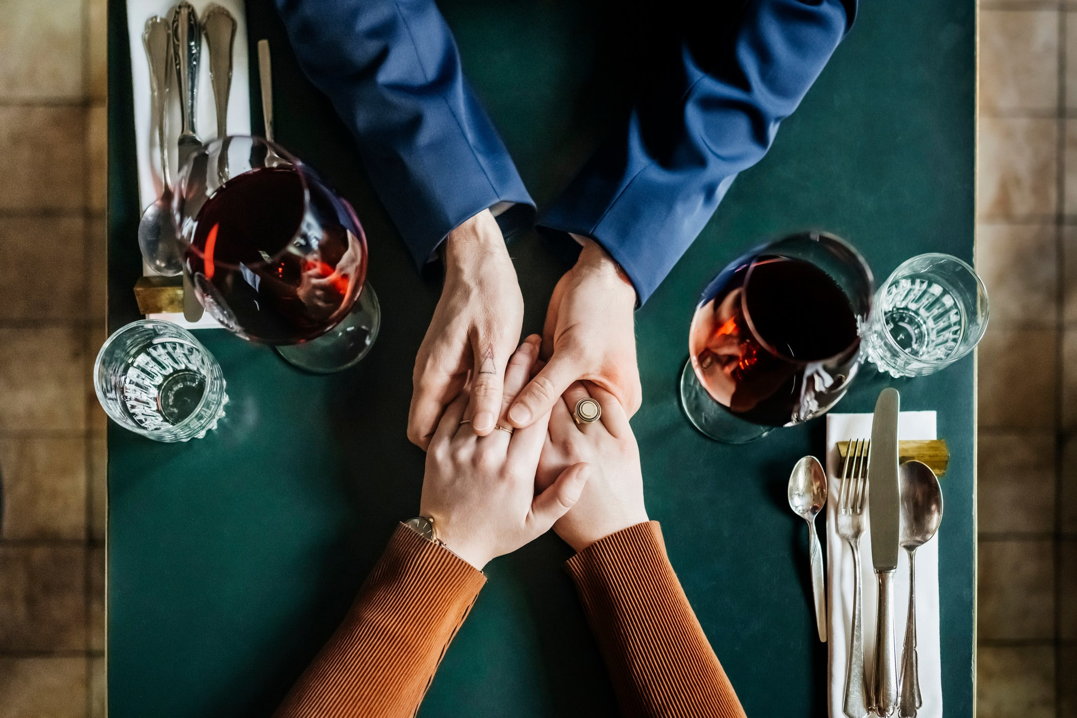 holding hands across a table