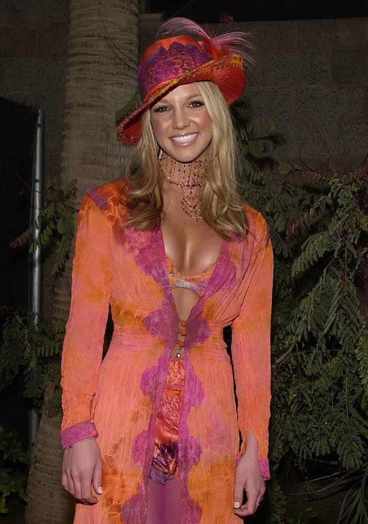 britney in a weird orange outfit