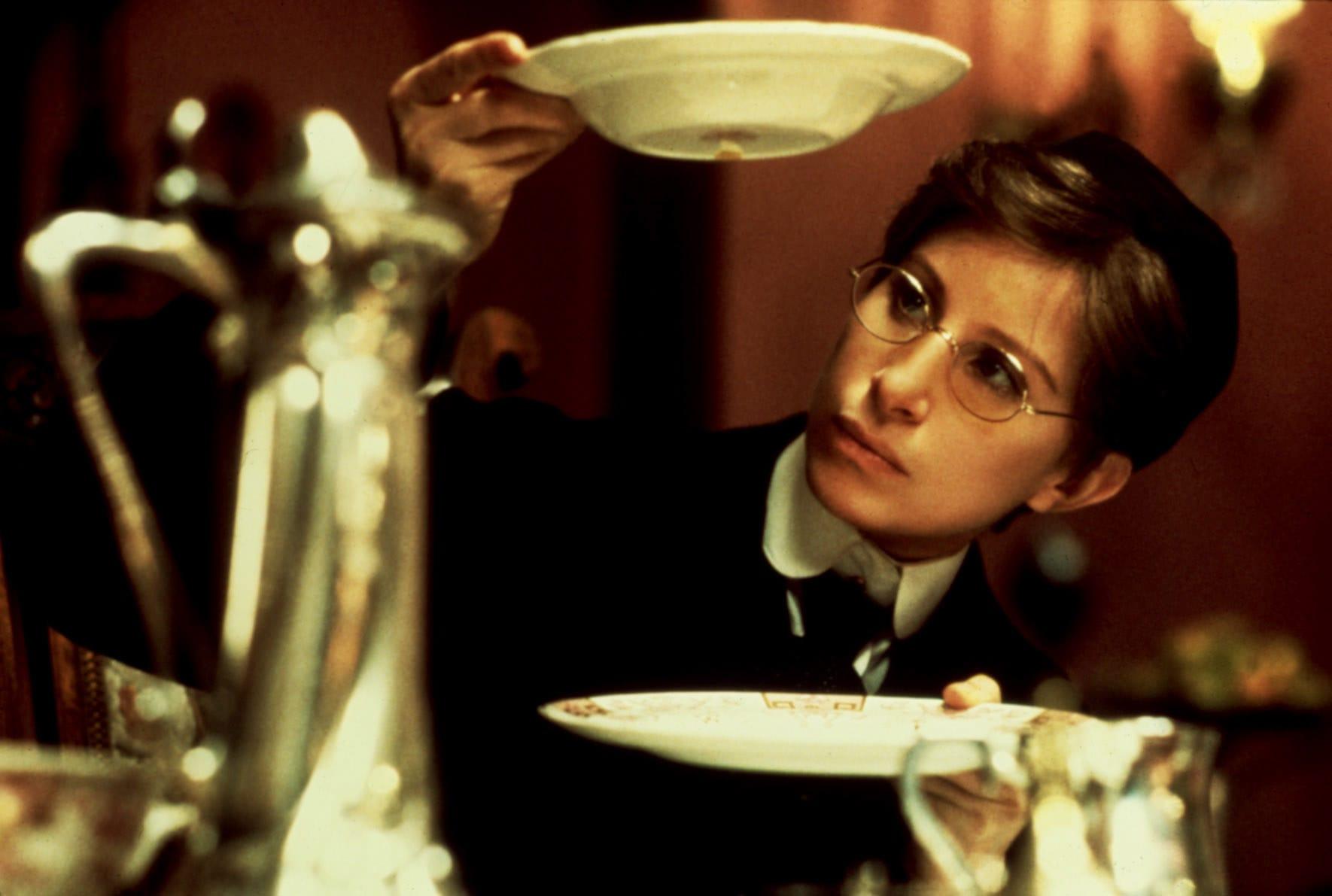 "Barbra Streisand holding a dish in ""Yentl"""