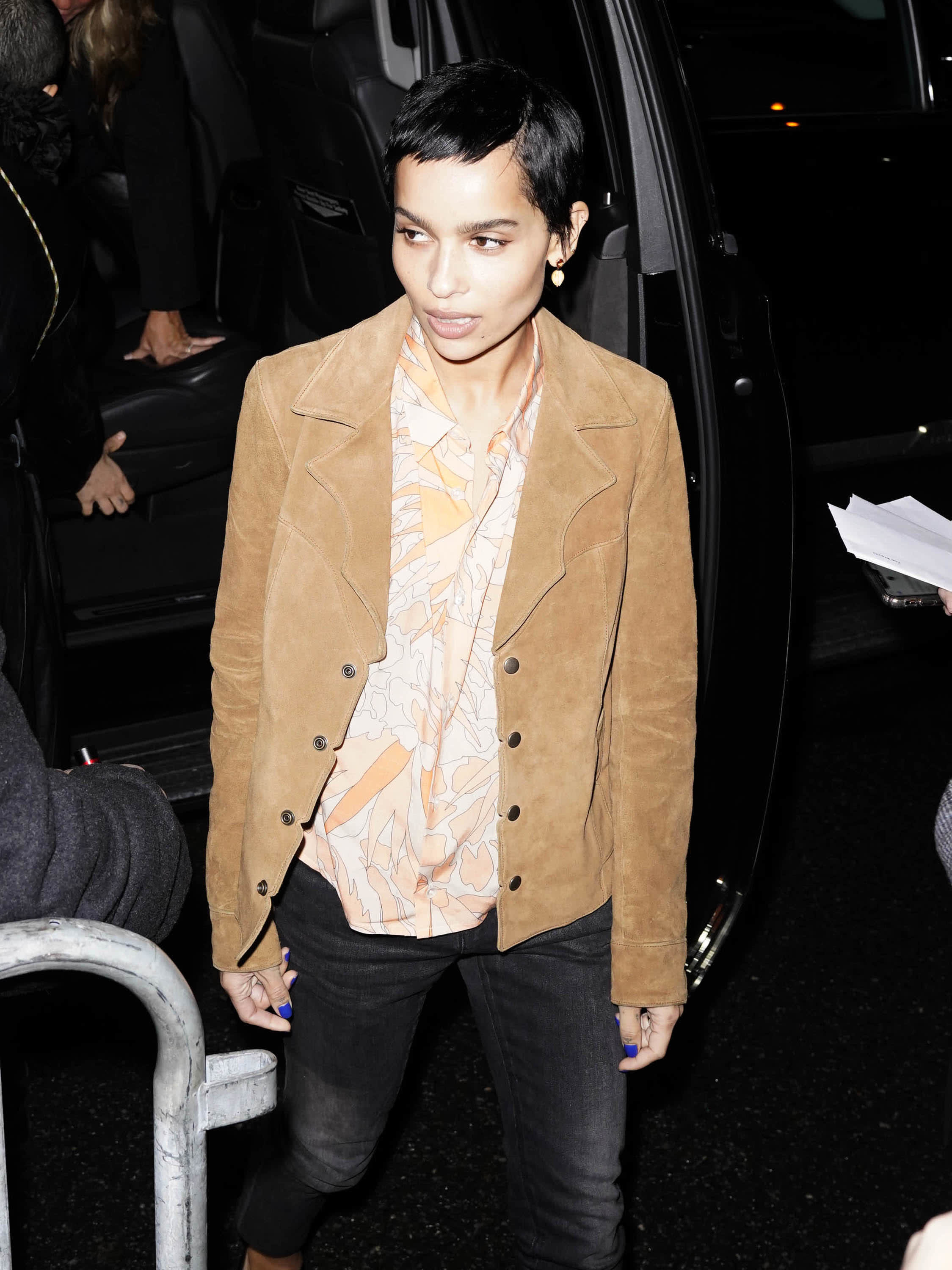Zoe in jeans large patterned shirt and western style suede jacket