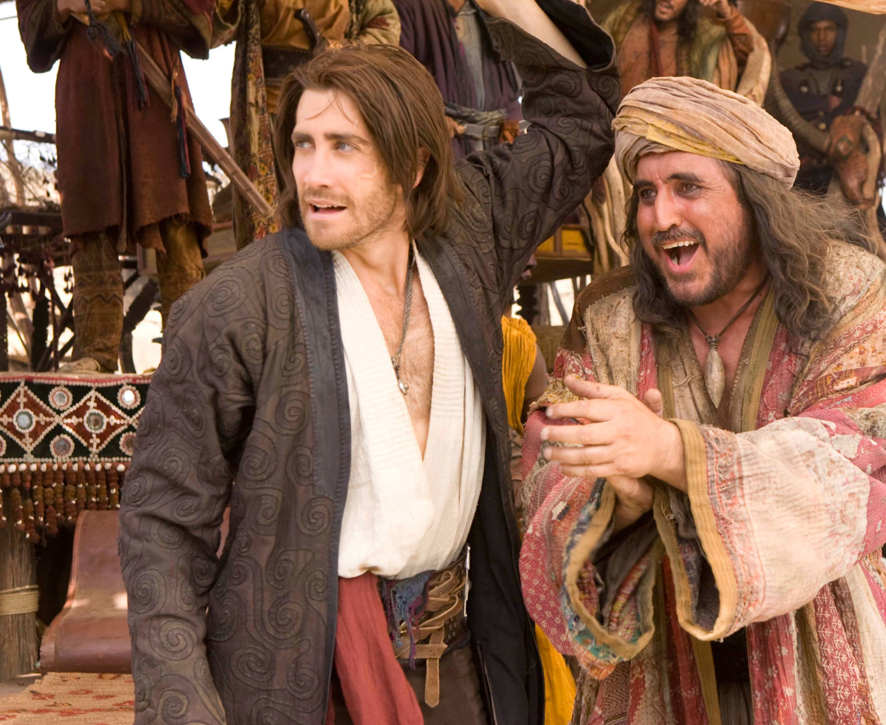 Jake Gyllenhaal's character Dastan stands next to Alfred Molina, who plays Sheik Amar