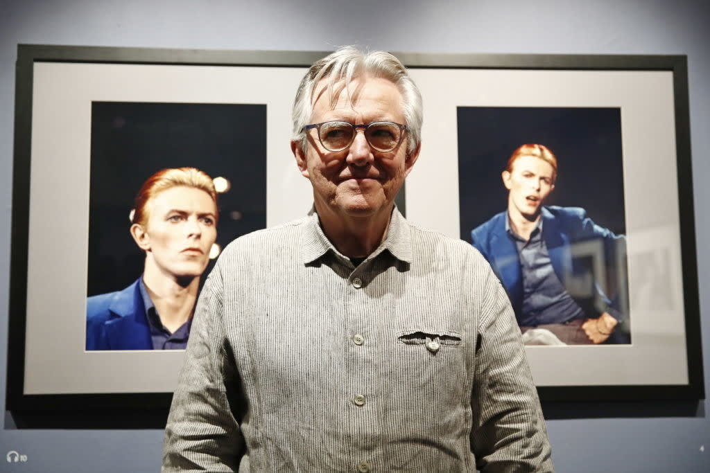 George Underwood at an exhibition featuring photography of David Bowie
