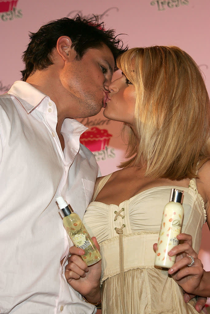 she's selling her lotion while kissing