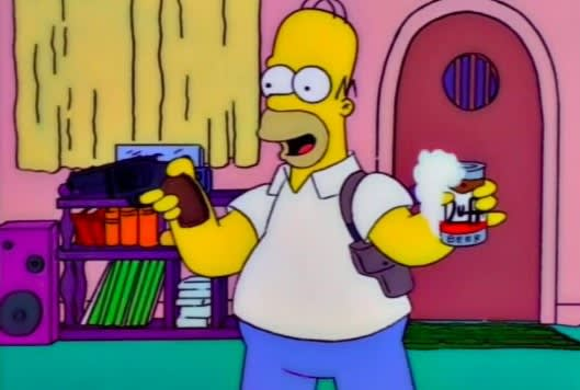 Homer holds a gun in one hand and a beer in another in the Simpsons