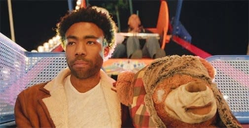 """Childish Gambino in his """"3005"""" music video, on a ferris wheel with a teddy bear"""