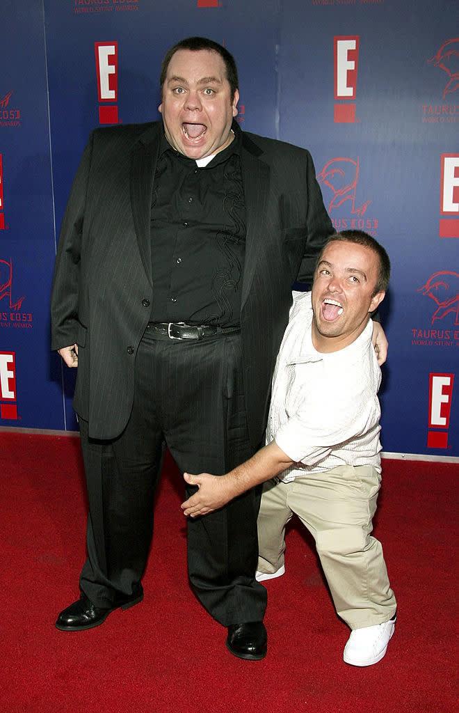 Preston and Jason posing on a red carpet