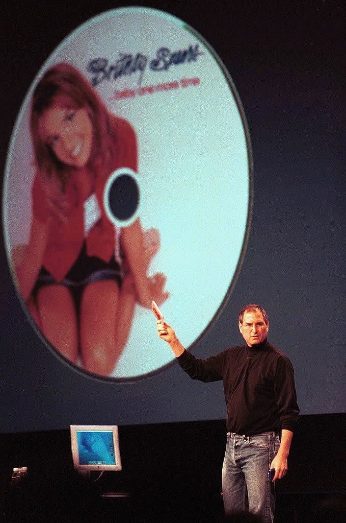 Steve Jobs holding up Britney Spears album Baby One More Time