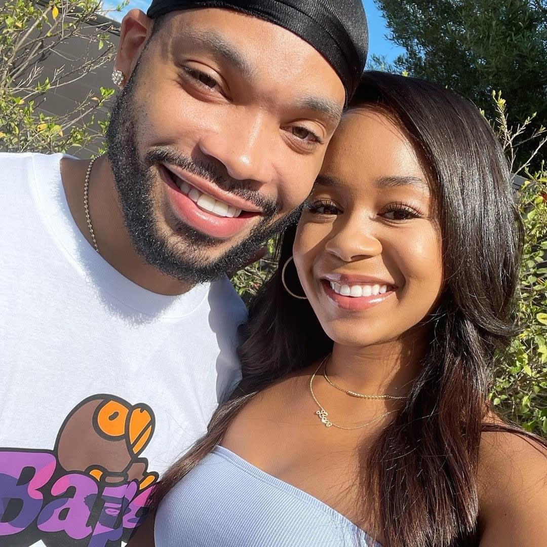 Eric and Jasmine smiling together outdoors