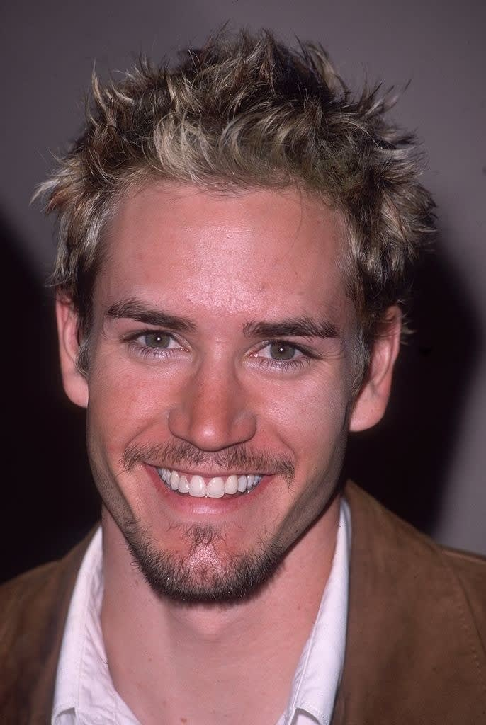 with frosted tips and a bad goatee