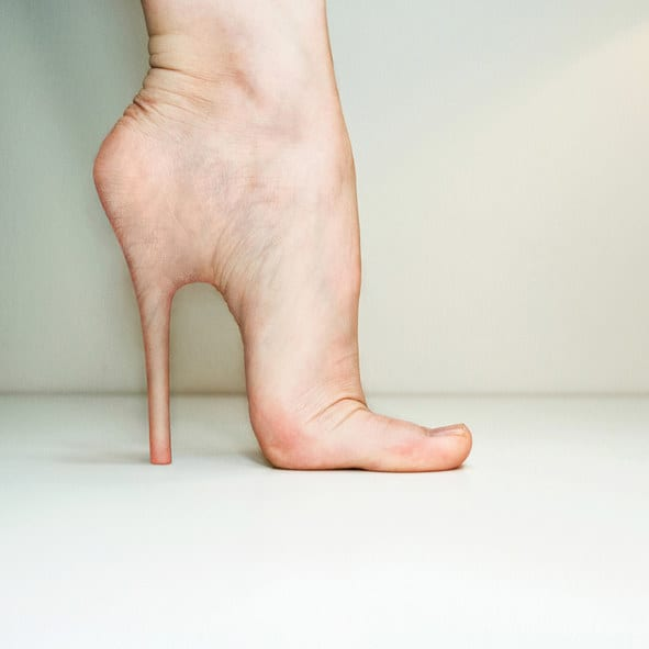 bare foot with a high heel coming out of the heel flesh